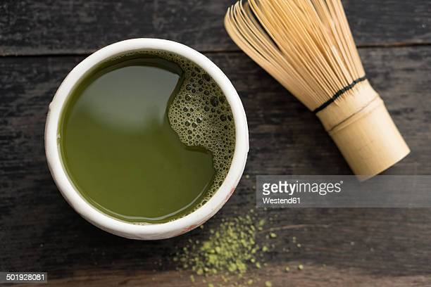 Green Matcha Tea in cup with Cha-sen
