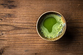 Top view of organic green matcha tea in a bowl