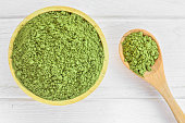 Green matcha tea powder in bowl