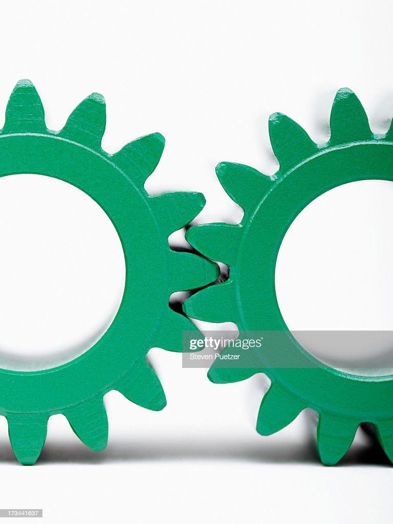 Green metal gears interlocked