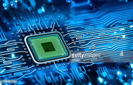 Green microchip set in a blue printed circuit board : Stock Photo