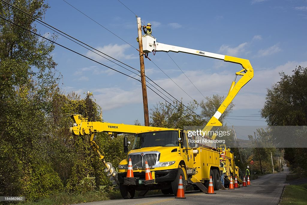 Green Mountain Power workmen add a transformer to residential power lines October 15 2012 in Charlotte Vermont Green Mountain Power is owned by Green...
