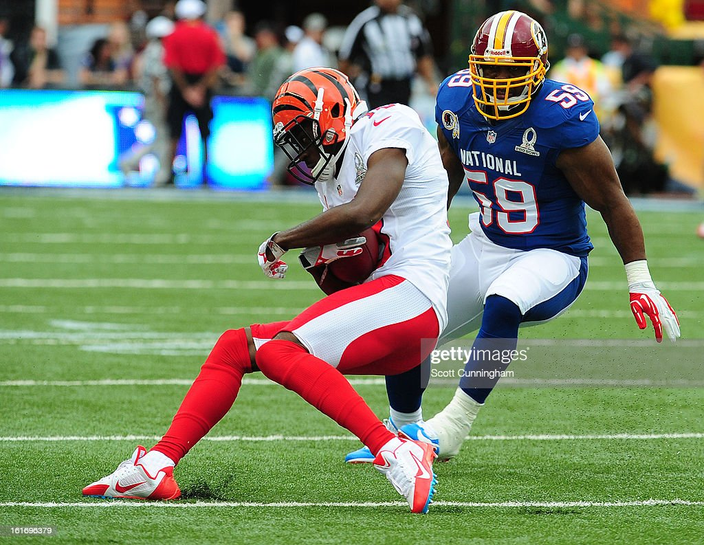 A. J. Green #18 of the Cincinnati Bengals and the AFC is tackled by London Fletcher #59 the National Football Conference team during the 2013 Pro Bowl at Aloha Stadium on January 27, 2013 in Honolulu, Hawaii