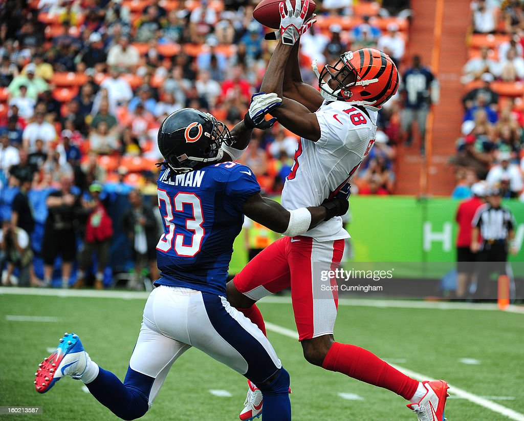 A. J. Green #18 of the Cincinnati Bengals and the AFC makes a catch against Charles Tillman #33 of the National Football Conference team during the 2013 Pro Bowl at Aloha Stadium on January 27, 2013 in Honolulu, Hawaii