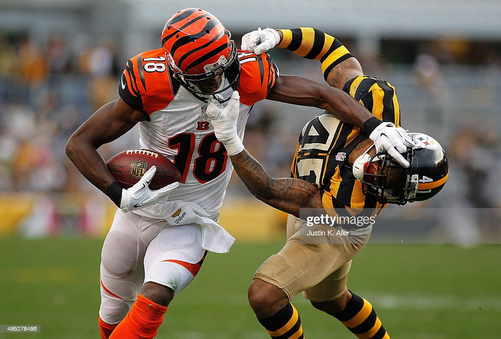 A.J. Green #18 of the Cincinnati Bengals attempts to shed Antwon Blake #41 of the Pittsburgh Steelers before both being called for face-mask penalties in the 4th quarter of the game at Heinz Field on November 1, 2015 in Pittsburgh, Pennsylvania.