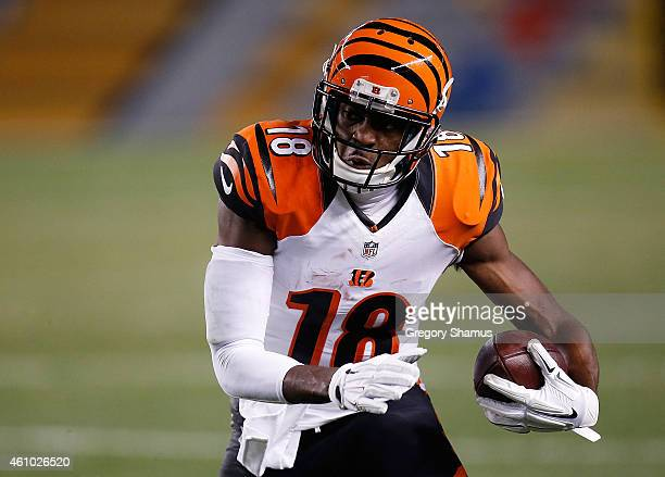 J Green of the Cincinnati Bengals carries the ball against the Pittsburgh Steelers at Heinz Field on December 28 2014 in Pittsburgh Pennsylvania