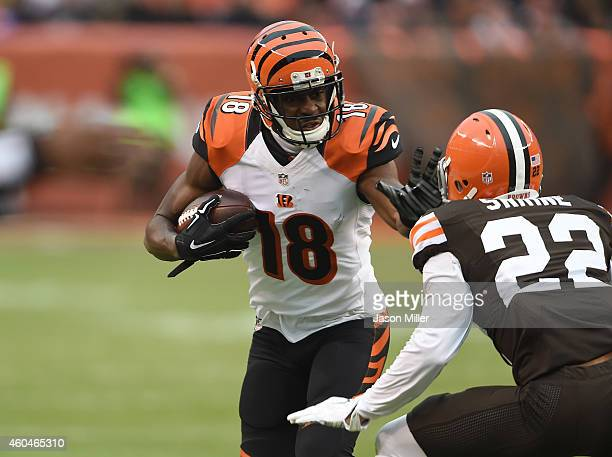 J Green of the Cincinnati Bengals carries the ball in front of Buster Skrine of the Cleveland Browns during the third quarter at FirstEnergy Stadium...