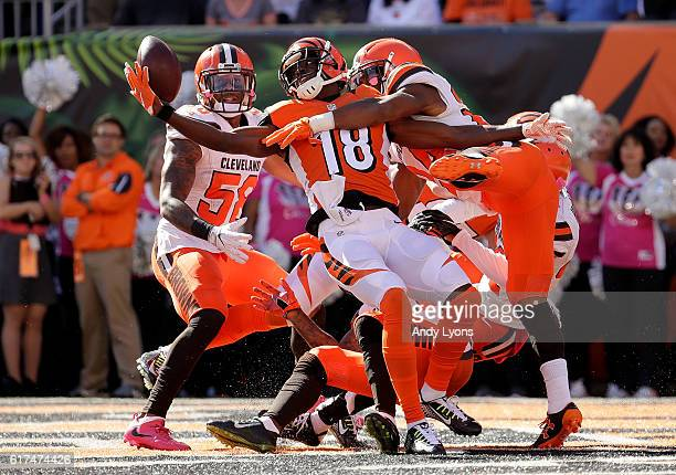 J Green of the Cincinnati Bengals catches a hail marry pass for a touchdown at the end of the second quarter of the game while being defended by...