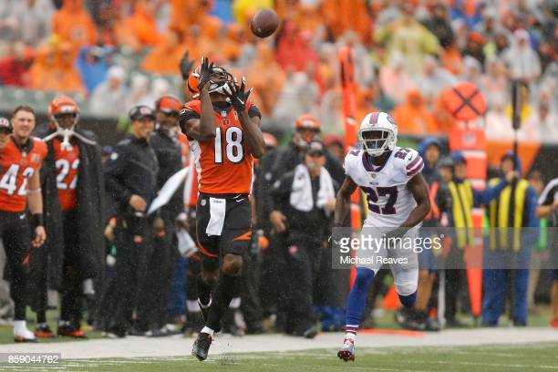 J Green of the Cincinnati Bengals catches a pass and runs it in for a touchdown while being defended by Tre'Davious White of the Buffalo Bills during...