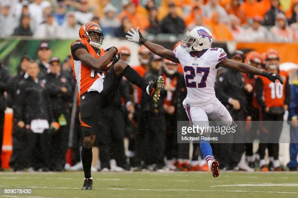 J Green of the Cincinnati Bengals catches a pass while being defended by Tre'Davious White of the Buffalo Bills during the third quarter at Paul...