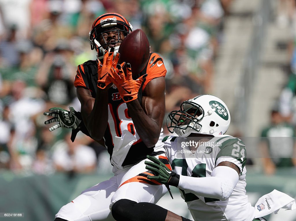 A.J. Green #18 of the Cincinnati Bengals catches a touchdown over Darrelle Revis #24 of the New York Jets during their game at MetLife Stadium on September 11, 2016 in East Rutherford, New Jersey.