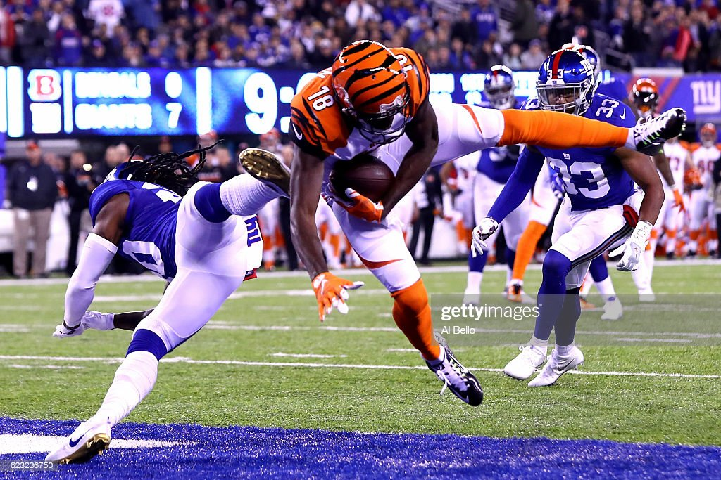 A.J. Green #18 of the Cincinnati Bengals catches a touchdown pass against Janoris Jenkins #20 of the New York Giants during the first quarter of the game at MetLife Stadium on November 14, 2016 in East Rutherford, New Jersey.