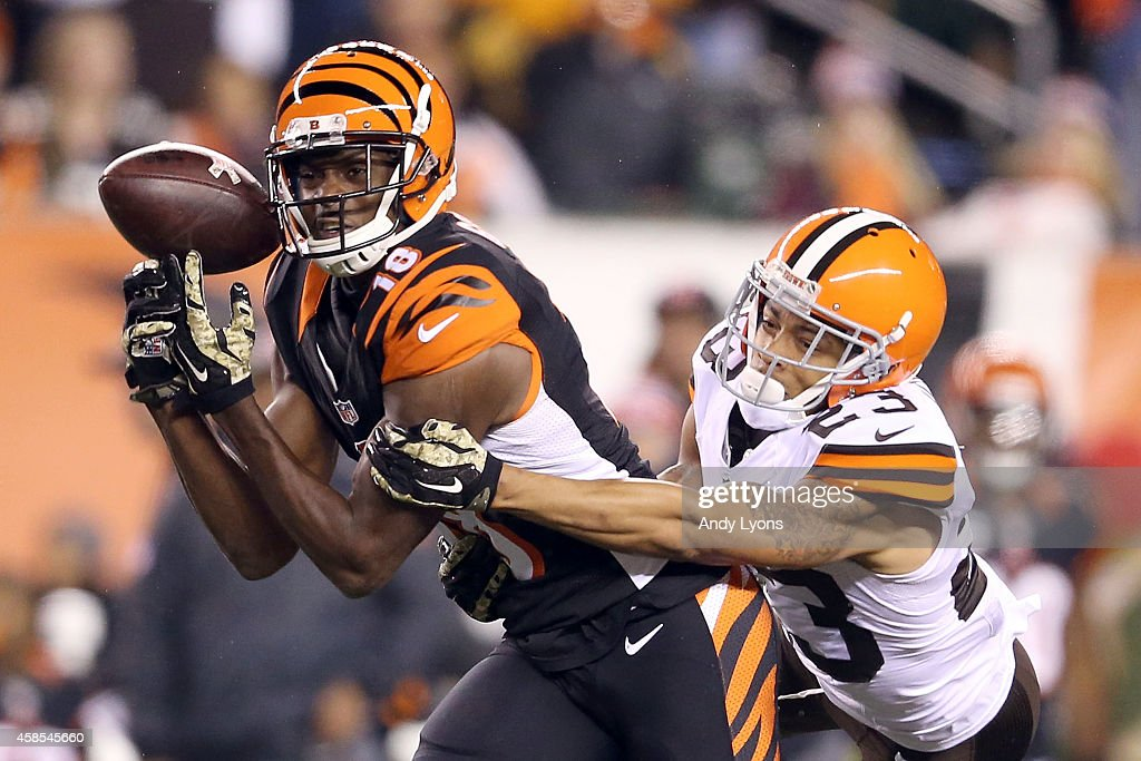 A.J. Green #18 of the Cincinnati Bengals drops a pass while being defended by Joe Haden #23 of the Cleveland Browns during the third quarter at Paul Brown Stadium on November 6, 2014 in Cincinnati, Ohio.