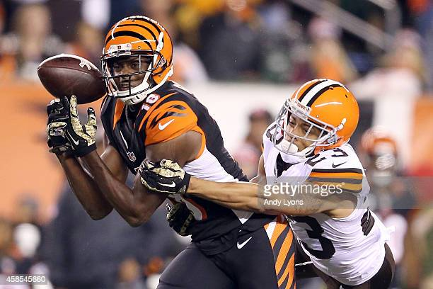 J Green of the Cincinnati Bengals drops a pass while being defended by Joe Haden of the Cleveland Browns during the third quarter at Paul Brown...