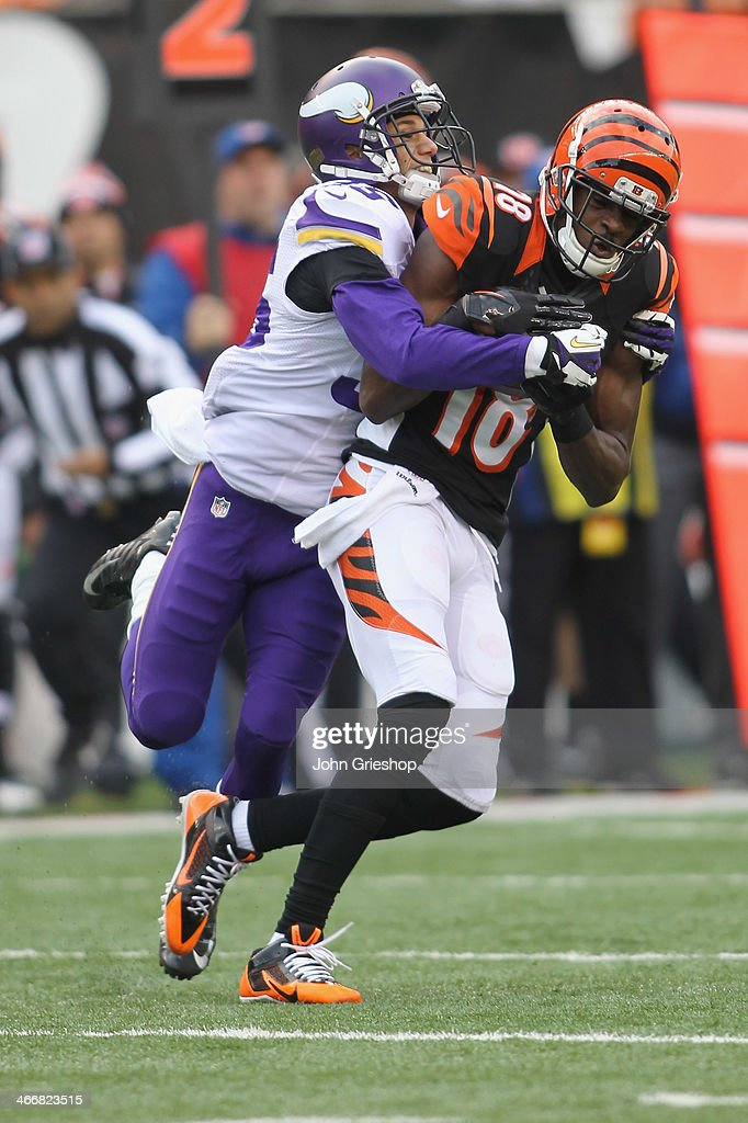 J Green of the Cincinnati Bengals hauls in the pass against Marcus Sherels of the Minnesota Vikings during their game at Paul Brown Stadium on...
