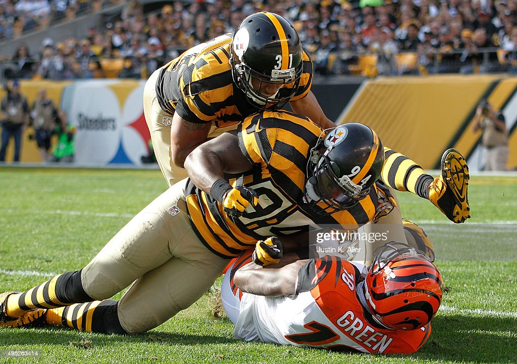 A.J. Green #18 of the Cincinnati Bengals is tackled by Stephon Tuitt #91 and Ross Cockrell #31 of the Pittsburgh Steelers during the 2nd quarter of the game at Heinz Field on November 1, 2015 in Pittsburgh, Pennsylvania.