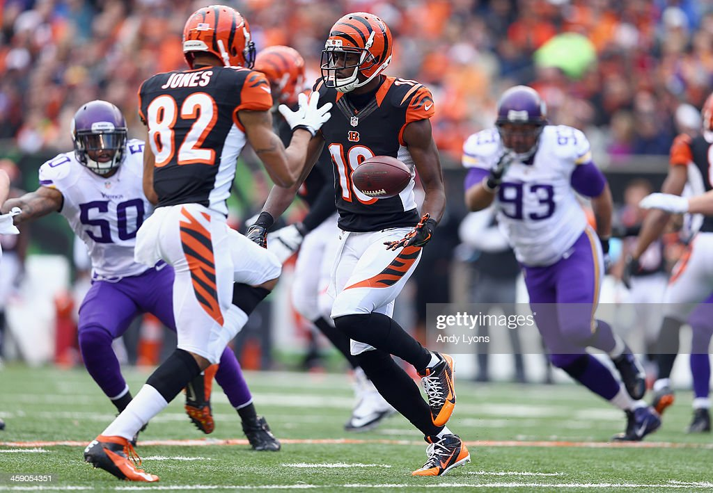<a gi-track='captionPersonalityLinkClicked' href=/galleries/search?phrase=A.J.+Green&family=editorial&specificpeople=5525868 ng-click='$event.stopPropagation()'>A.J. Green</a> #18 of the Cincinnati Bengals pitches the ball to Marvin Jones #82 during the NFL game against the Minnesota Vikings at Paul Brown Stadium on December 22, 2013 in Cincinnati, Ohio.