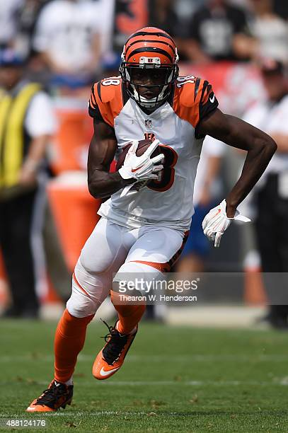 J Green of the Cincinnati Bengals runs after a catch against the Oakland Raiders during the first half of their NFL game at Oco Coliseum on September...