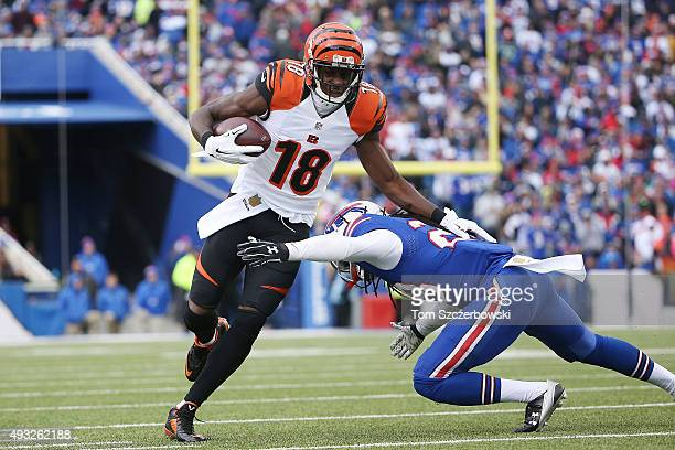 J Green of the Cincinnati Bengals runs after the catch as Corey Graham of the Buffalo Bills defends during the second half at Ralph Wilson Stadium on...