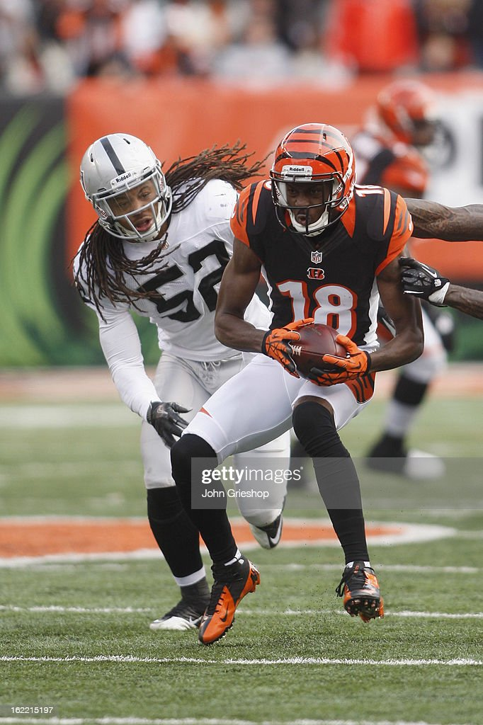 <a gi-track='captionPersonalityLinkClicked' href=/galleries/search?phrase=A.J.+Green&family=editorial&specificpeople=5525868 ng-click='$event.stopPropagation()'>A.J. Green</a> #18 of the Cincinnati Bengals runs the ball upfield during the game against the Oakland Raiders at Paul Brown Stadium on November 25, 2012 in Cincinnati, Ohio.