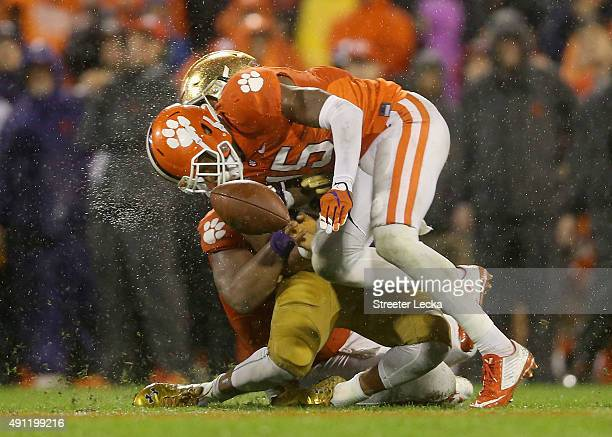 J Green of the Clemson Tigers hits DeShone Kizer of the Notre Dame Fighting Irish during their game at Clemson Memorial Stadium on October 3 2015 in...