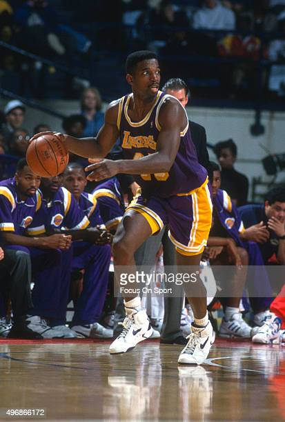 C Green of the Los Angeles Lakers dribbles the ball against the Washington Bullets during an NBA basketball game circa 1992 at the Capital Centre in...