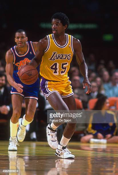 C Green of the Los Angeles Lakers dribbles the ball against the Phoenix Suns during an NBA basketball game circa 1986 at the Forum in Los Angeles...