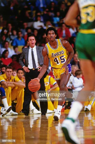 C Green of the Los Angeles Lakers dribbles the ball up the court against the Seattle Supersonics during a game circa 1988 at The Forum in Los Angeles...
