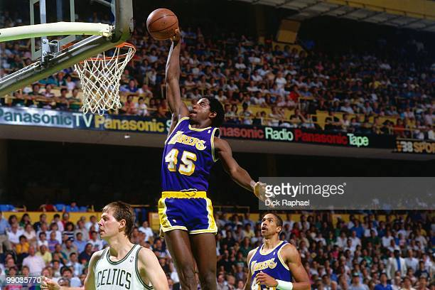 C Green of the Los Angeles Lakers dunks against Danny Ainge of the Boston Celtics during the 1987 NBA Finals at the Boston Garden in Boston...