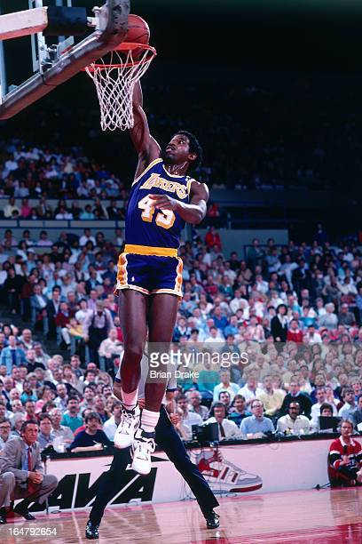 C Green of the Los Angeles Lakers dunks against the Portland Trail Blazers during a game played circa 1987 at the Veterans Memorial Coliseum in...