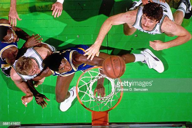C Green of the Los Angeles Lakers fights for a rebound against the Boston Celtics during a game circa 1988 at the Boston Garden in Boston...