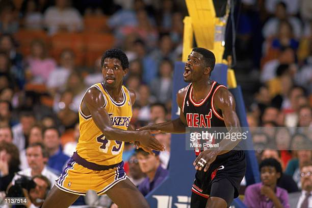 C Green of the Los Angeles Lakers guards Grant Long of the Miami Heat during an NBA game at the Great Western Forum in Los Angeles California in 1988