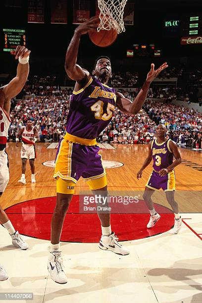 Green of the Los Angeles Lakers rebounds against the Portland Trailblazers at the Veterans Memorial Coliseum in Portland Oregon circa 1992 NOTE TO...