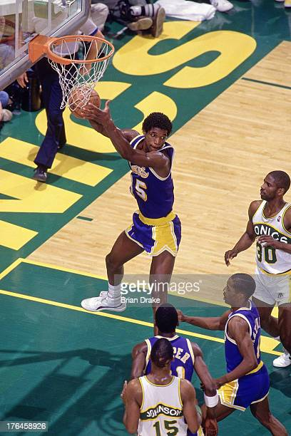 C Green of the Los Angeles Lakers rebounds against the Seattle SuperSonics during a game played in 1987 at the Seattle Coliseum in Seattle Washington...