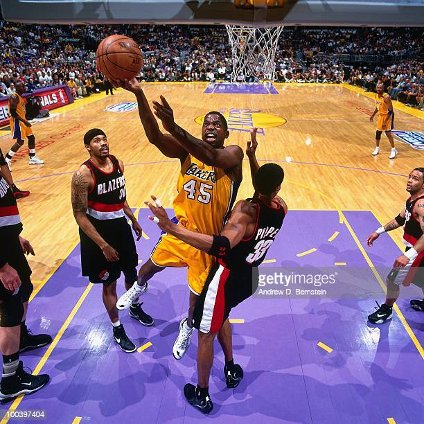 C Green of the Los Angeles Lakers shoots a layup against Scottie Pippen of the Portland Trail Blazers in Game One of the Western Conference Finals...