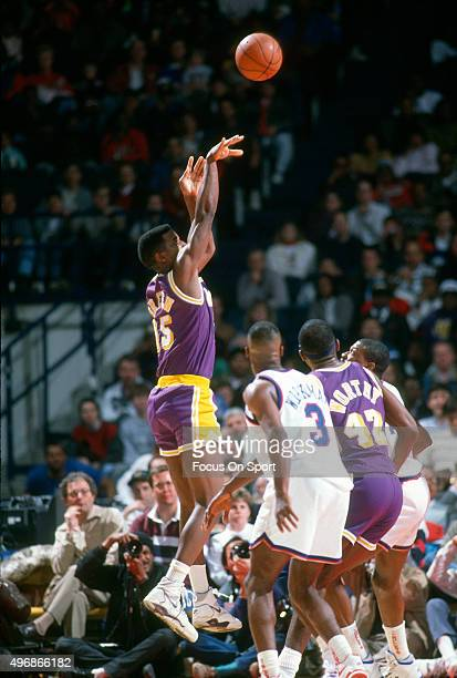 C Green of the Los Angeles Lakers shoots against the Washington Bullets during an NBA basketball game circa 1991 at the Capital Centre in Landover...