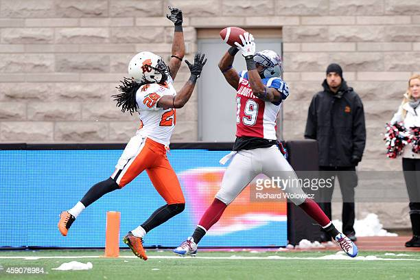 J Green of the Montreal Alouettes catches the ball for a touchdown in front of Cord Parks of the BC Lions during the CFL Eastern Division SemiFinal...