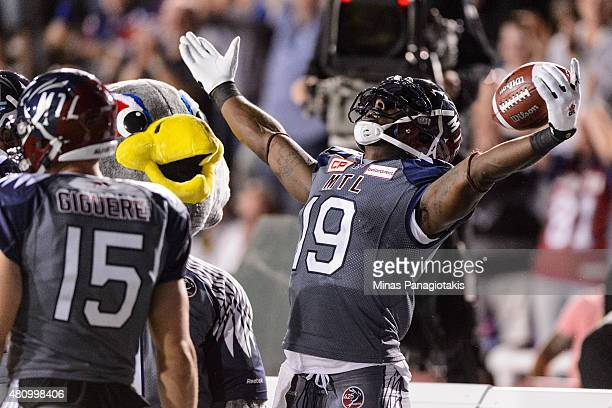 J Green of the Montreal Alouettes celebrates his touchdown during the CFL game against the Hamilton TigerCats at Percival Molson Stadium on July 16...