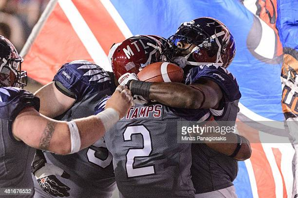 J Green of the Montreal Alouettes celebrates his touchdown with teammates during the CFL game against the Hamilton TigerCats at Percival Molson...