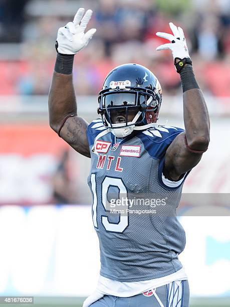 J Green of the Montreal Alouettes reacts to the crowd as he takes to the field during the CFL game against the Hamilton TigerCats at Percival Molson...