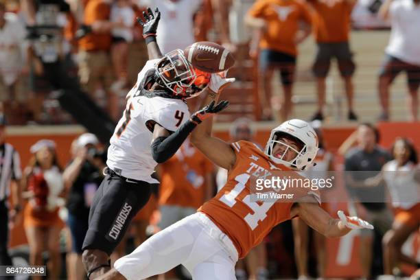 J Green of the Oklahoma State Cowboys defends a pass intended for Lorenzo Joe of the Texas Longhorns in overtime at Darrell K RoyalTexas Memorial...
