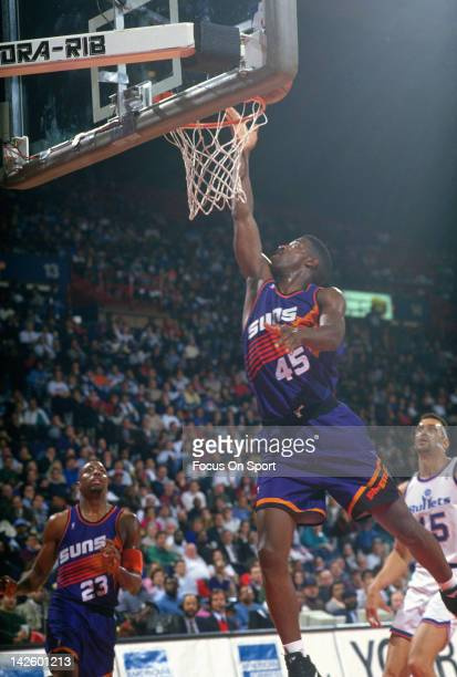 C Green of the Phoenix Suns lays the ball up against the Washington Bullets during an NBA basketball game circa 1994 at the Capital Centre in...