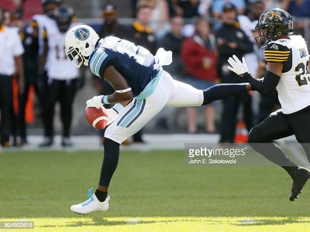 J Green of the Toronto Argonauts makes a catch against on Chris Davis of the Hamilton TigerCats during a CFL game at BMO Field on June 25 2017 in...