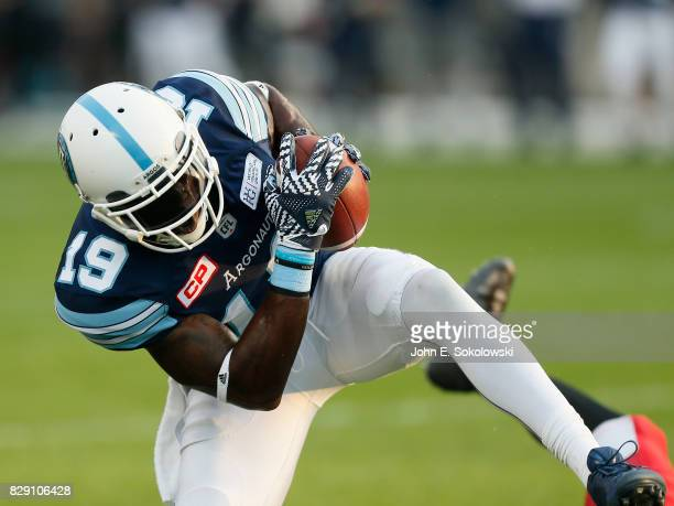 J Green of the Toronto Argonauts makes a catch against the Calgary Stampeders during a CFL game at BMO Field on August 3 2017 in Toronto Ontario...