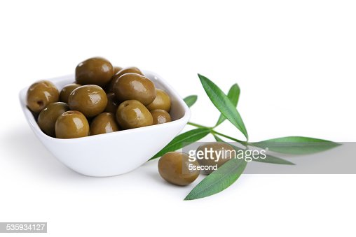Green olives in bowl isolated on white : Stock Photo
