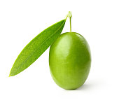 Green olive with leaves isolated on white