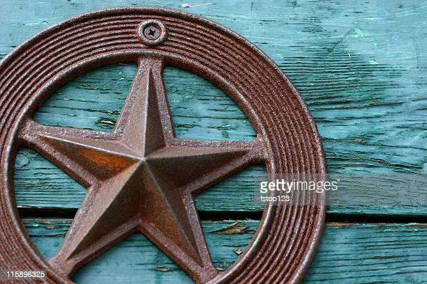 Green paint peeling, old wooden box, rustic iron Texas star.