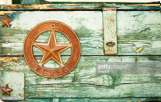 Green paint peeling on Wooden box with Texas star