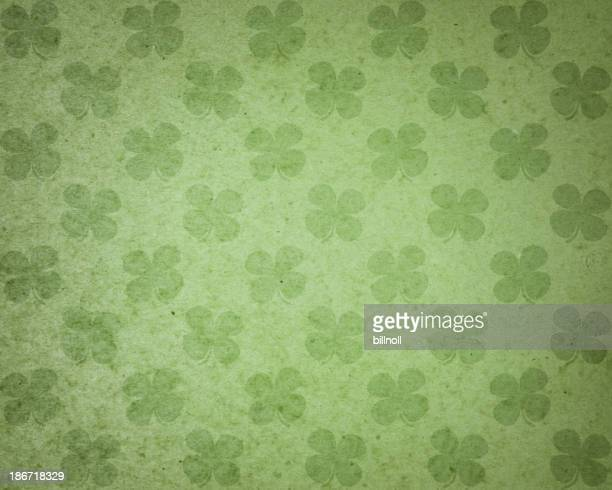 green paper with clover pattern