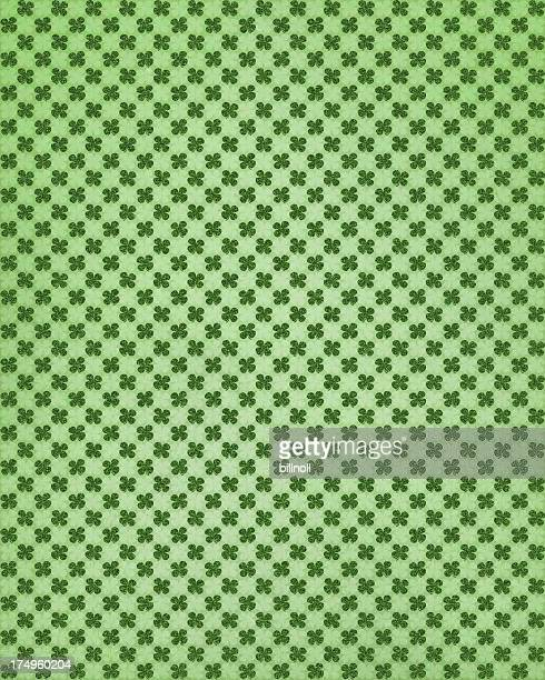 green paper with clover patterns